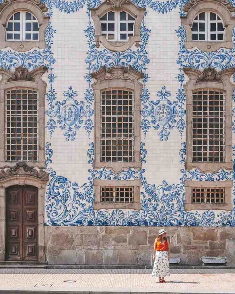 Girl standing in front of tiled church in Porto