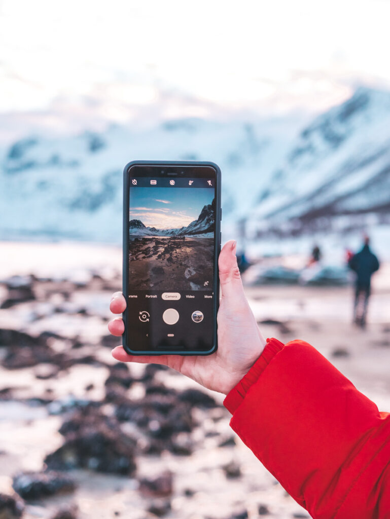 Phone taking a photo in Tromso Arctic Fjords