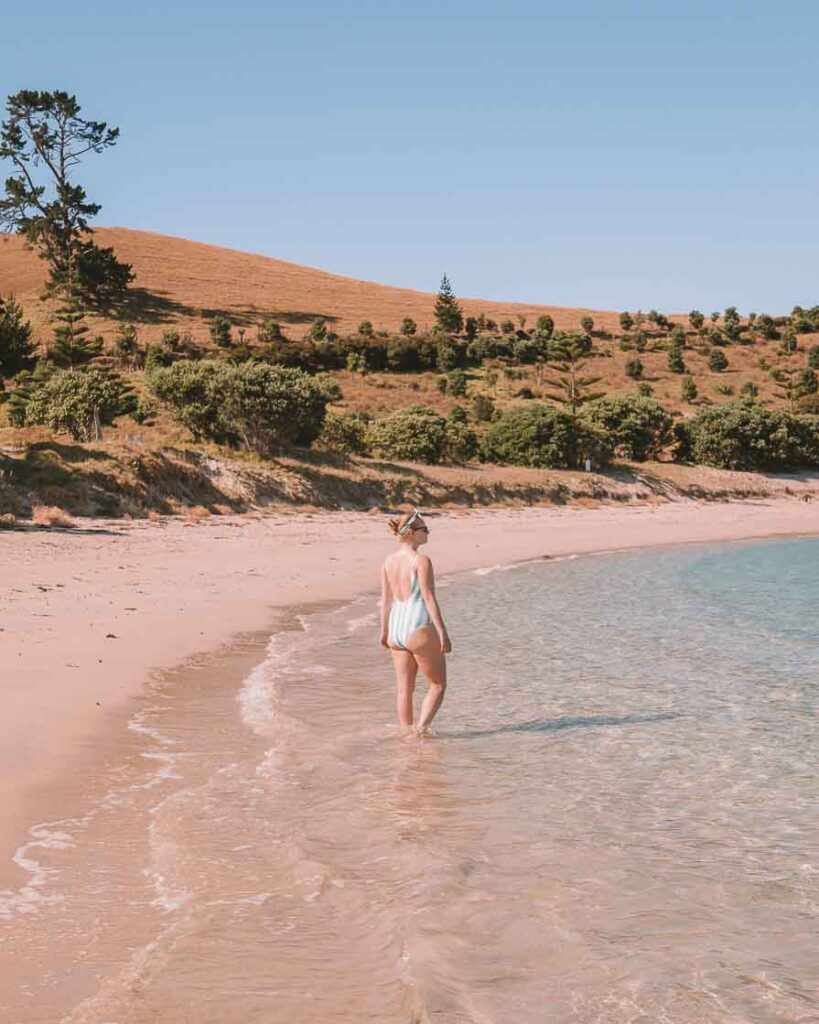 Girl standing in the water on Slipper Island beach