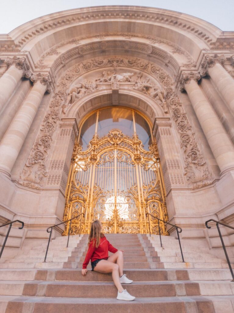 Girl sitting on steps in front of Le Petit Palais