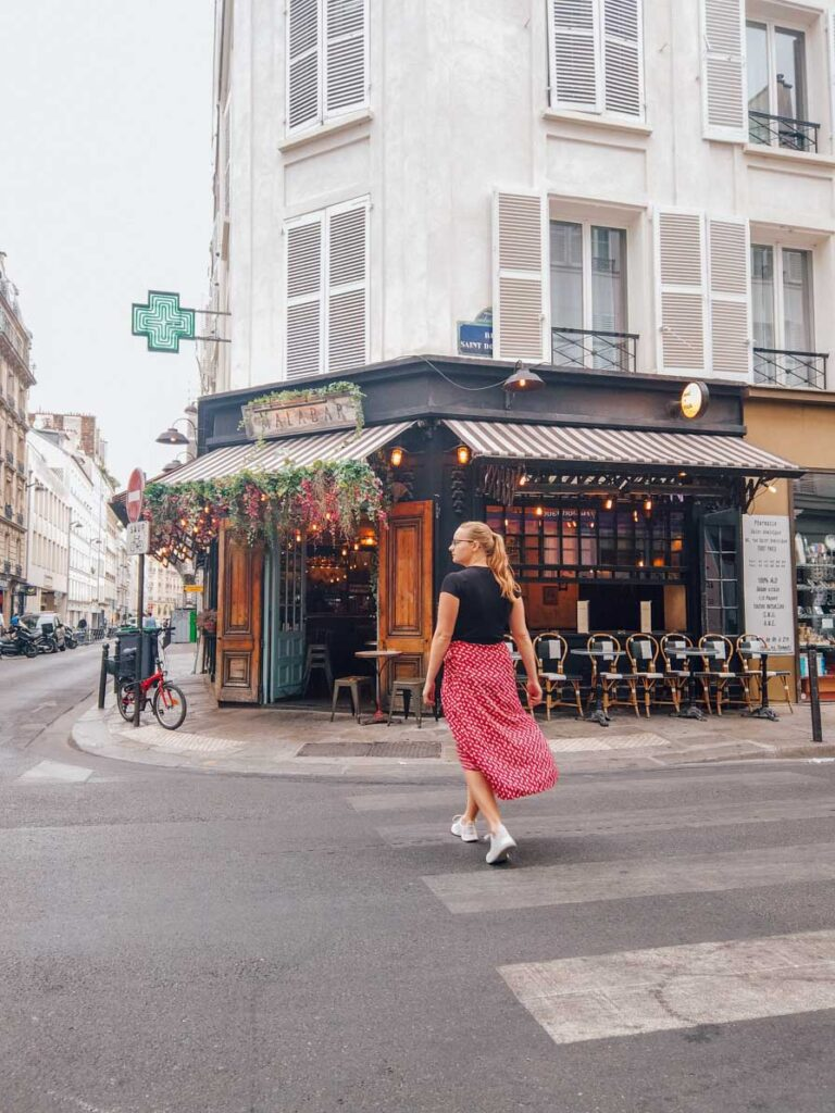 Girl walking in front of Malabar Cafe in Paris