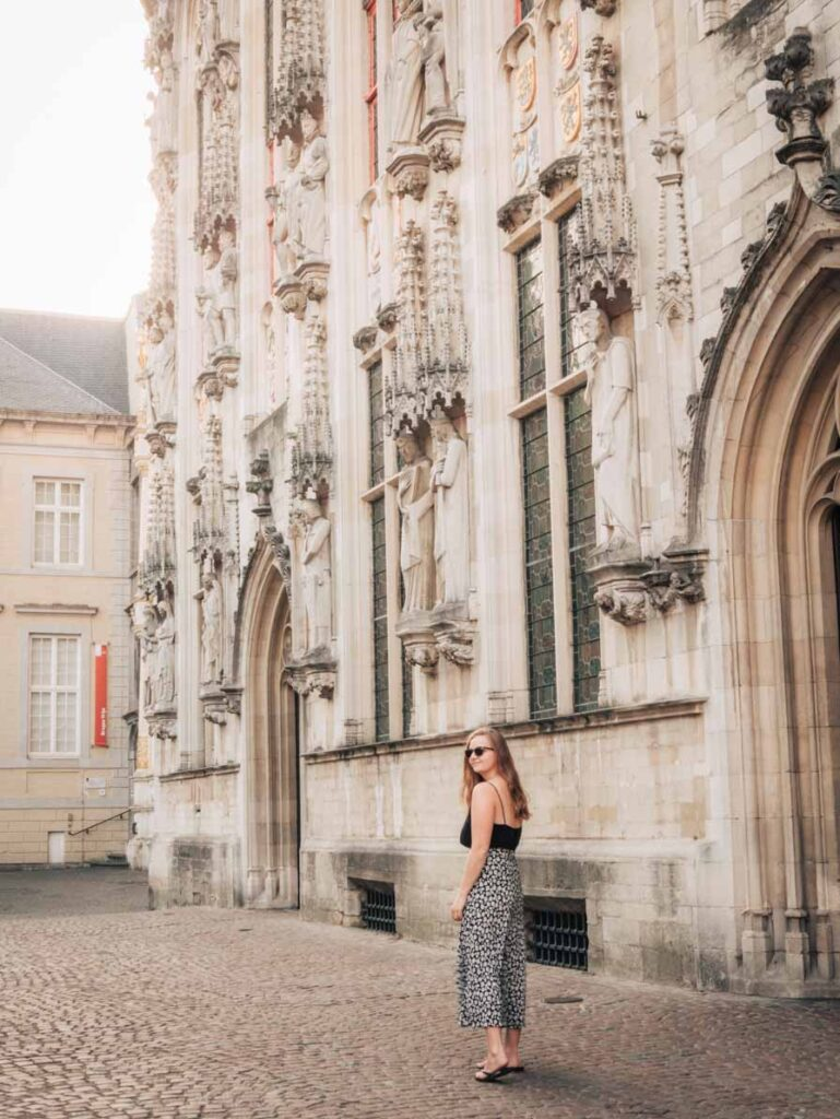 Bruges gothic architecture with girl walking in front