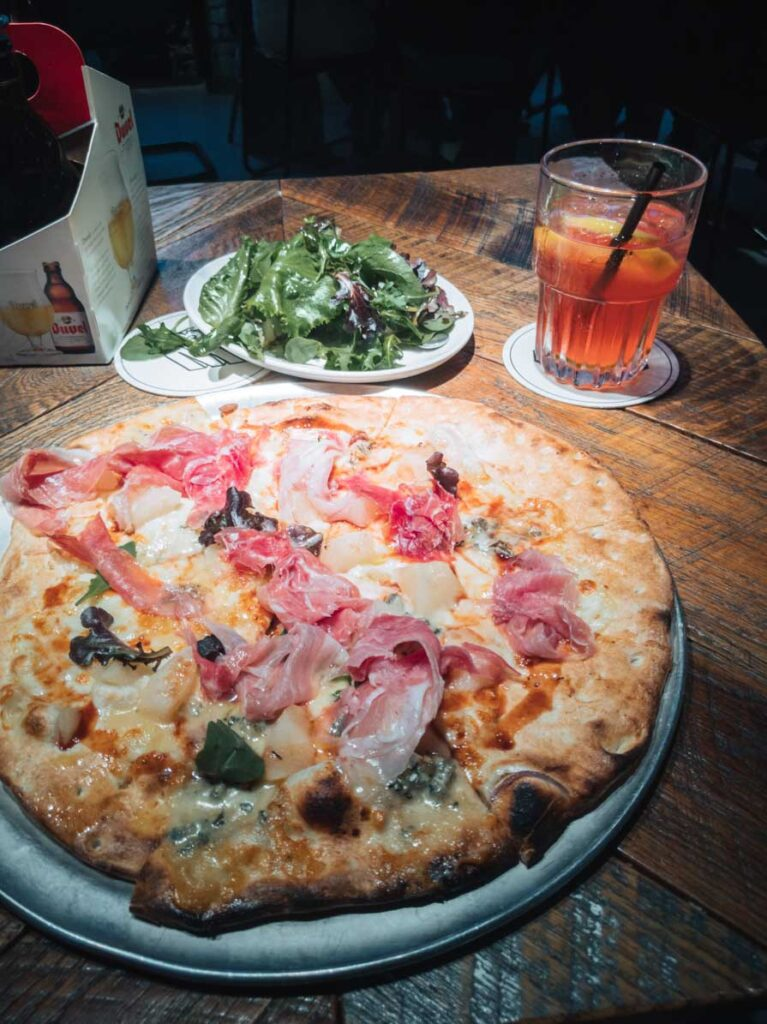 Pizza and iced tea at restaurant in Ghent, Belgium