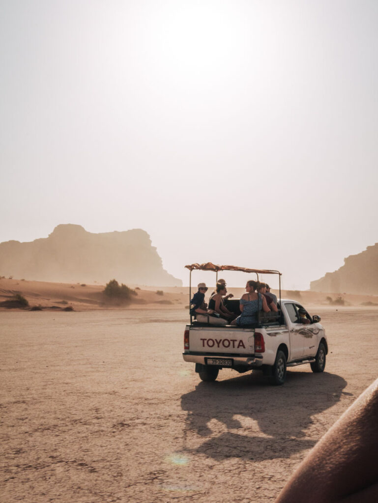 Tourists in back of jeep on Wadi Rum desert safari