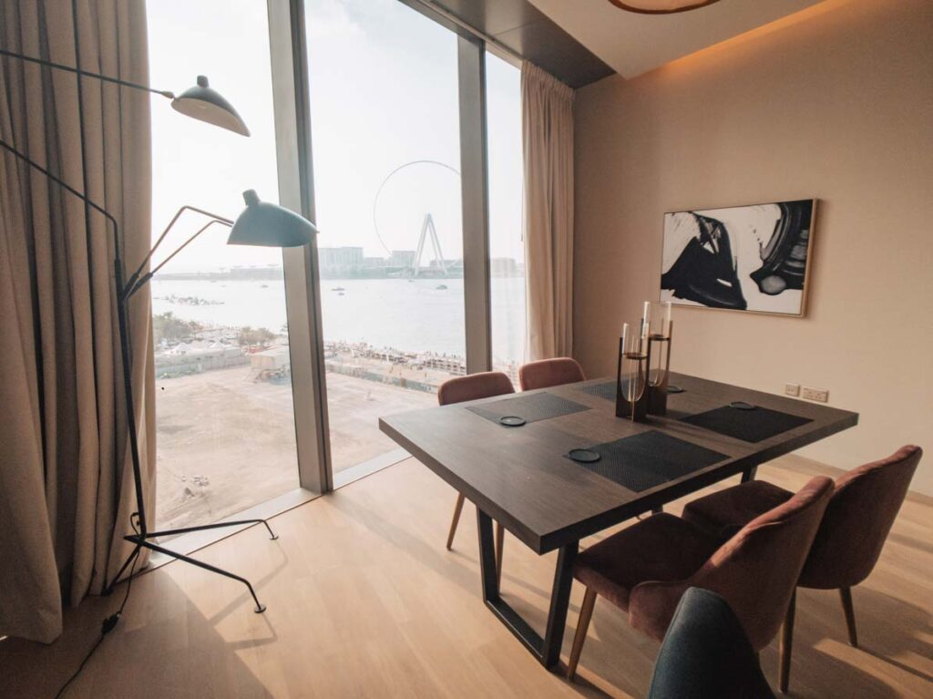 Dining table in apartment with view over Dubai beach