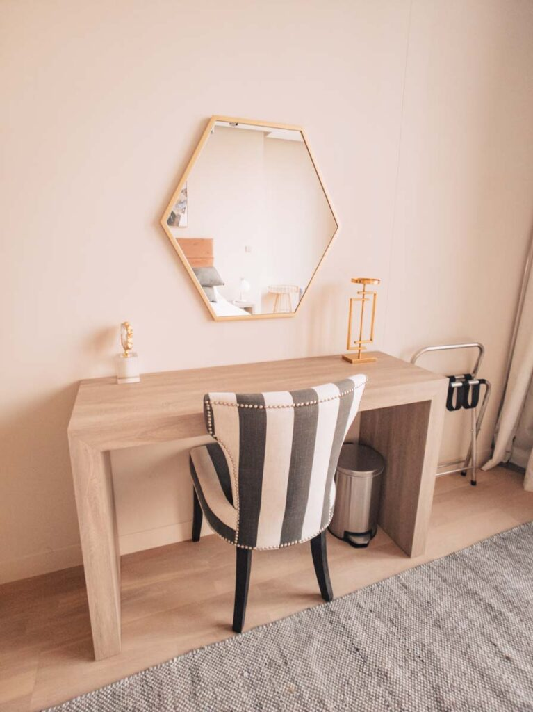 Desk and chair with mirror in Dubai apartment
