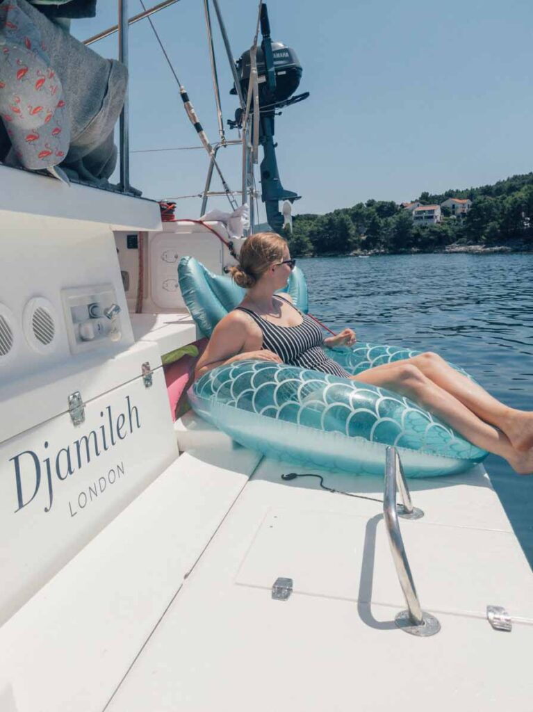 Relaxing in inflatable mermaid in Croatia on a yacht