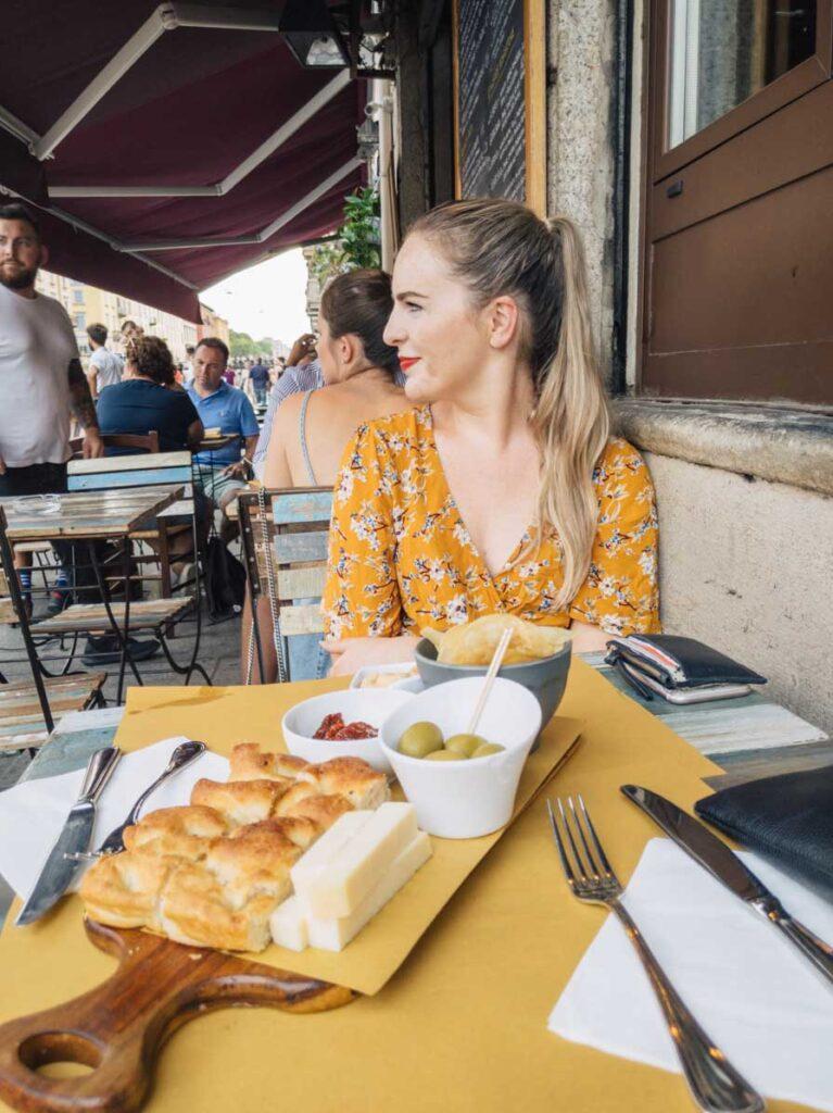 Girl eating lunch in MIlan