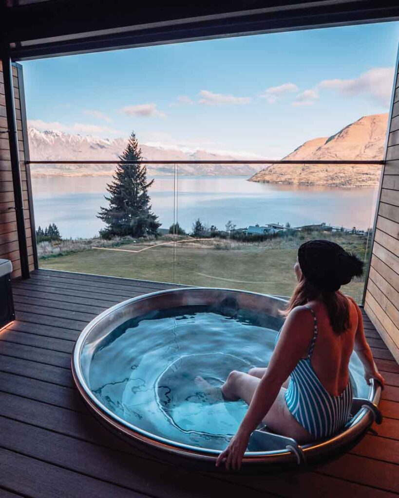 Girl sitting in a hot tub in Queenstown at Kamana Lakehouse