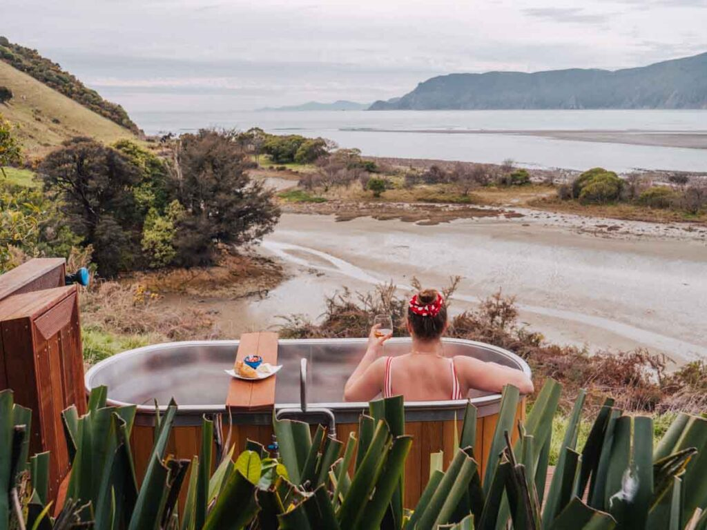 Outdoor bath tub at Pepin Island glamping in New Zealand