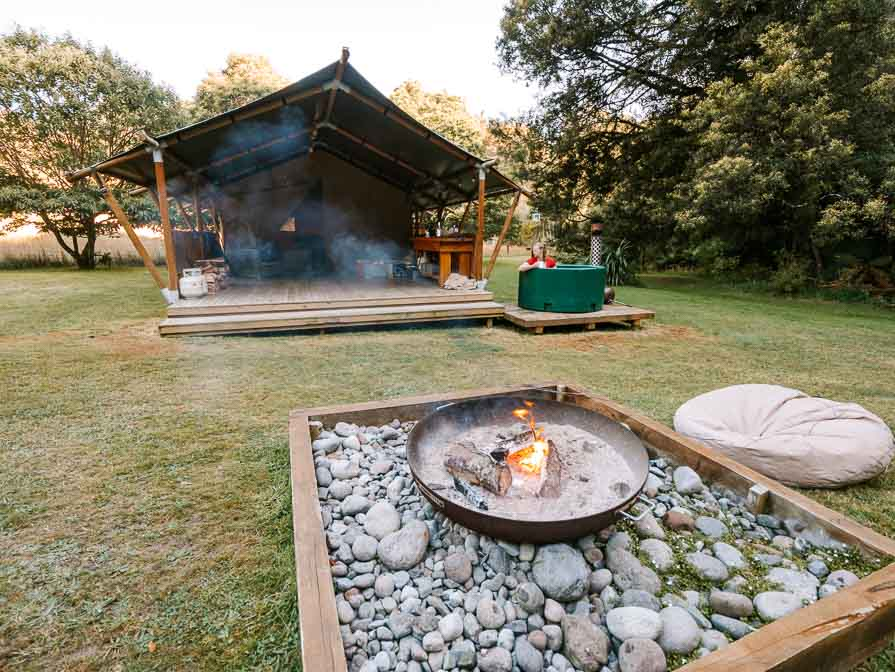 glamping tent with fire in front