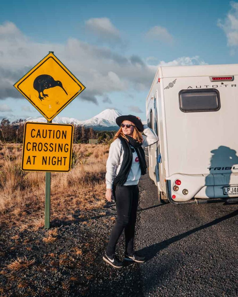 girl doing a north island road trip in a campervan