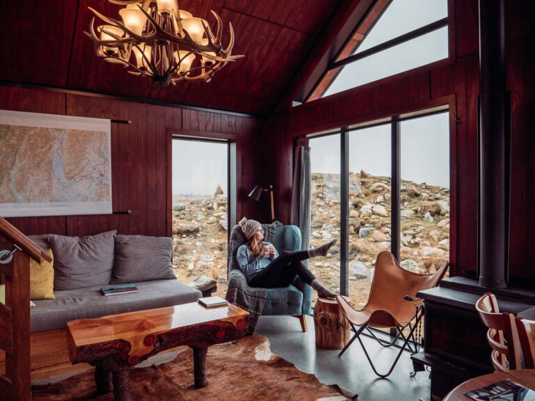 girl sitting on chair in high country cabin twizel