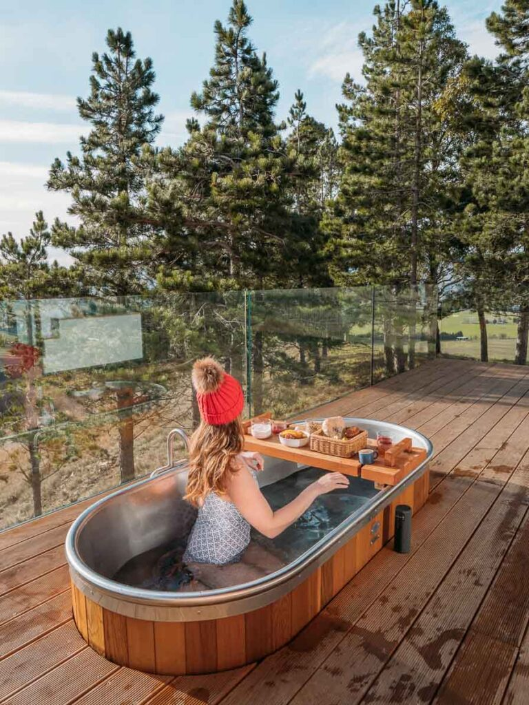 girl in outdoor bath at nest treehouse